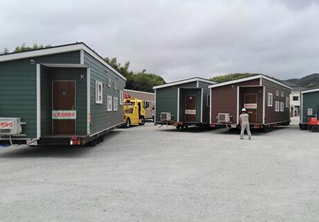 お盆の混雑時を避け8月16日~22日に10台仮設住宅予定地に到着